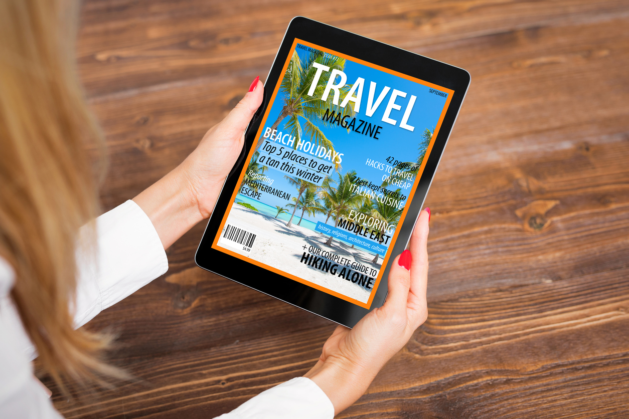 Reading travel magazine on tablet
